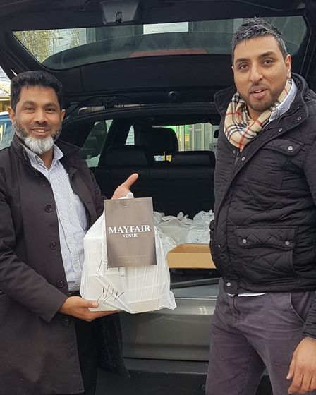 Wazid (left) and his Mayfairweddings venue managerJas Singhdelivering food tohospitals and care homes