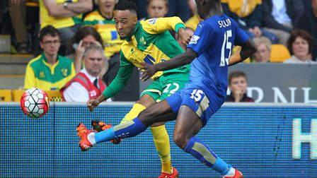 Nathan Redmond of Norwich and Jeff Schlupp of Leicester City in action during the Barclays Premier L