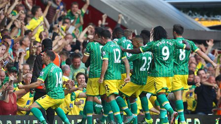 Wes Hoolahan leads the celebrations at West Ham after his pass for Nathan Redmond's put him top of t