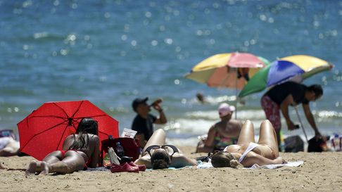 People enjoy the weather on Bournemouth beach in Dorset. Picture date: Saturday June 5, 2021.
