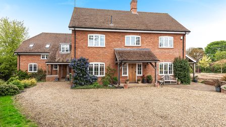 Large brick-built family home set back from the road and approached by a shingle driveway