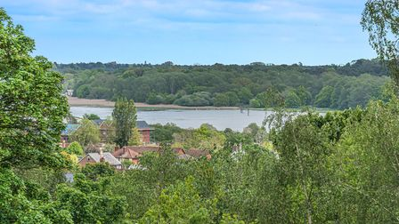 View taken from a window overlooking rooftops and the river towards Sutton Hoo beyond