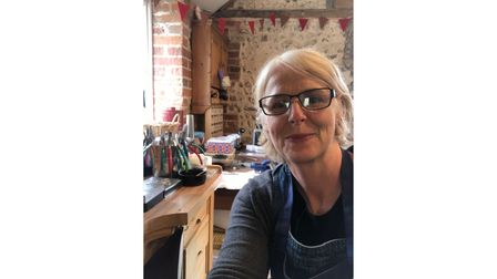 Claire in her at-home workshop