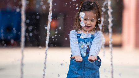 Adria having fun in the fountain on the Cornhill Picture: SARAH LUCY BROWN