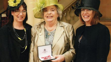 Doris Langford with her MBE and daughters,Sara-Jane Maskell (left) and Elizabeth Hovey (right)
