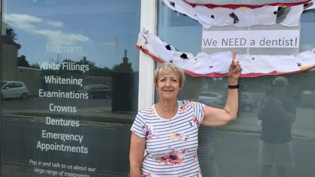 Sandra Ellis with the yarn-bombing design she created to call for a dentist in Leiston