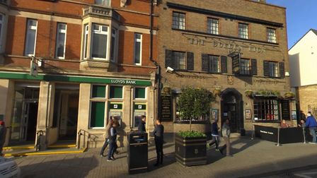 Police are currently on the scene outside the Golden Lion pub in Newmarket