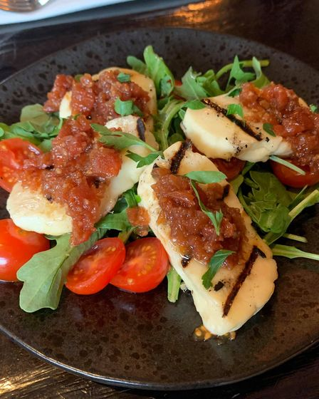 The grilled halloumi with herb marinated cherry tomatoes and salsa at The River Bar in Cambridge.