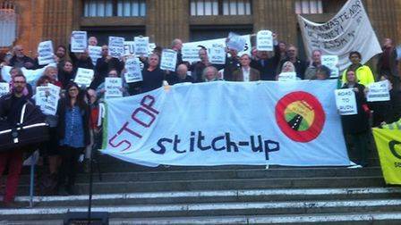 Protesters opposed to the Northern Distributor Road gather outside Norwich City Hall.