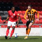 Hull City's Tom Eaves (right) and Crewe Alexandra's Omar Beckles (left) battle for the ball during t