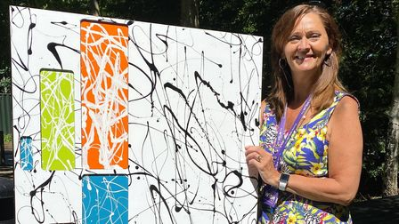 Sue Smith with the artwork donated by mysterious Suffolk artist The Hat
