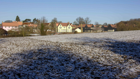 Large houses on a frosty hill. The houses are just projections