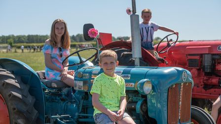Zahra, Charlie and Freddie on the tractor's. Picture: Sarah Lucy Brown