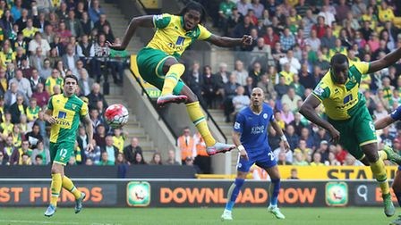 Dieumerci Mbokani of Norwich scores his side's first goal during the Barclays Premier League match a