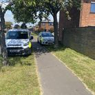 Police remain on scene at Cherwell Way, Gorleston after the body of a woman was discovered following a house fire.