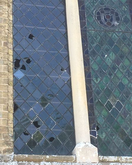 Damage to the far left window at Coates Church.