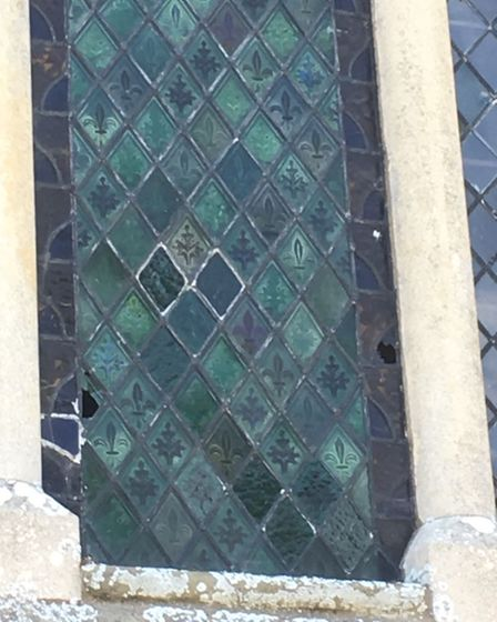 Damage to the coloured stained glass window at Coates Church.
