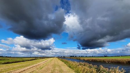 The big skies of the Fens on the river running alongside Bank House Meadows