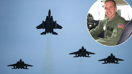 U.S. Air Force F-15C Eagles assigned to the 493rd Fighter Squadron conduct a missing-man formation d