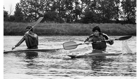 A pair of Deben canoe club members giving it their all in the regatta at Woodbridge in 1984