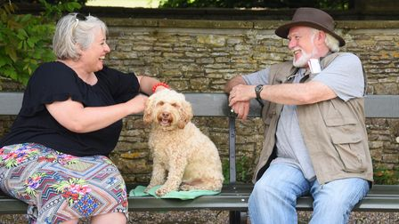 Claire Cumberlidge, with her dog Star, enjoying a chat in the shade with Phil Wade during the hot we