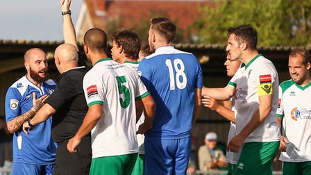 Chris Henderson of Lowestoft Town is yellow carded during the FA Cup Qualifying second round match a