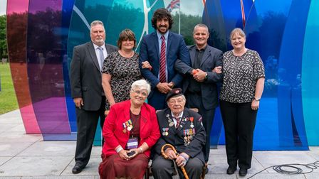 D-Day veteran Alan King, from Eye, with family and friends at the National Memorial Arboretum