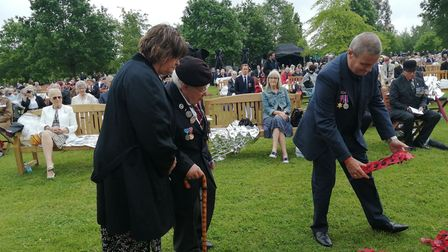 D-Day veteran Alan King, from Eye, laying a wreath at the National Memorial Arboretum