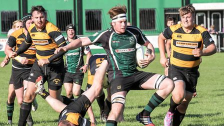 Action from North Walsham's victory over Letchworth Garden City at Scottow, second row and man of th