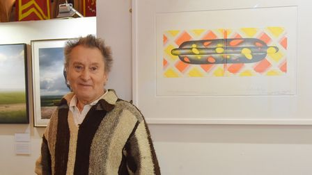 Colin Self with one of his hot dog pictures atArt Fair East in Norwich in 2018.