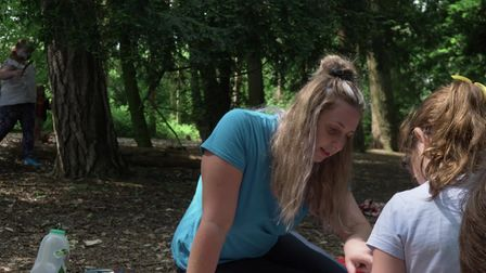 Suffolk Family Carers volunteer and young carer in woods