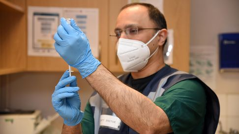 Doctore Parikh with the Pfizer vaccine Picture: CHARLOTTE BOND