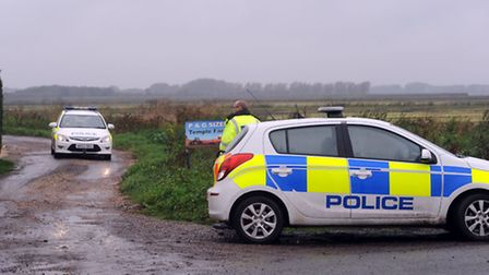 Emergency services at the scene of a plane crash at Shippea Hill.