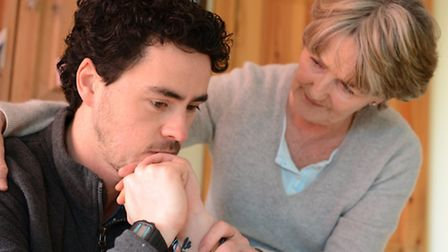 Mental Health. Pictured: A man is supported and comforted by his mother. Picture: Newscast Online