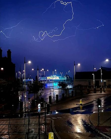 A lightning strike caught on camera over Lowestoft. A Met Office warning shows more is on the way.