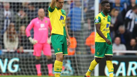 The Norwich players look dejected after conceding their sides 3rd goal during the Barclays Premier L
