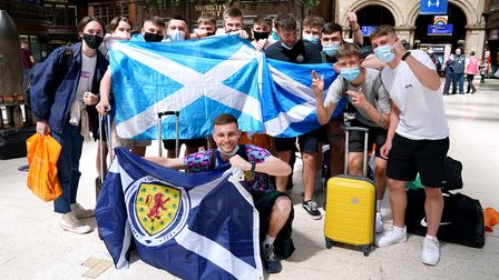 Scotland fans at Central station in Glasgow as they prepare to travel to London ahead of the UEFA Eu