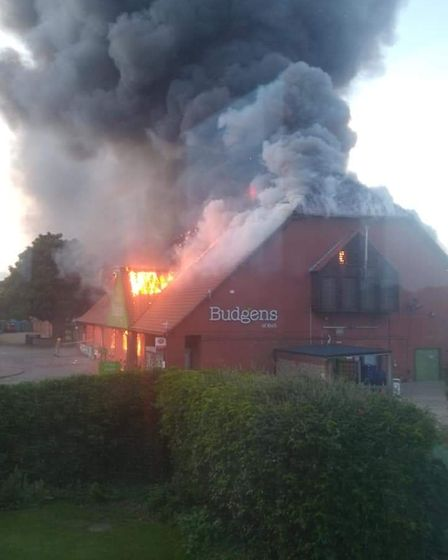 Budgens in Holt has gone up in flames Picture: Alan Ely