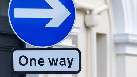 A British directional road sign, one way right