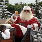 FREE TO USE IMAGES Pictured: Passers by and players were surprised to find Santa and his sleigh at
