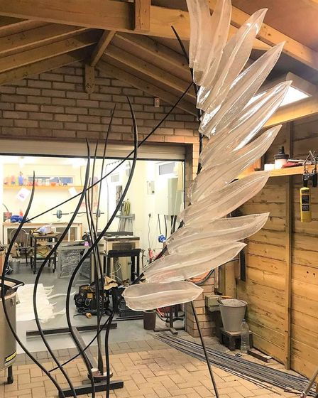 Glass-blower Layne Rowe's stunning angel wings sculpture 'Solace'
