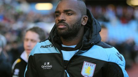 Aston Villa's Darren Bent makes his way to the substitutes bench for the match