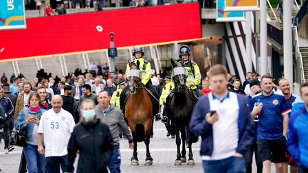 Mounted police patrol outside of Wembley Stadium as fans arrive ahead of the UEFA Euro 2020 Group D