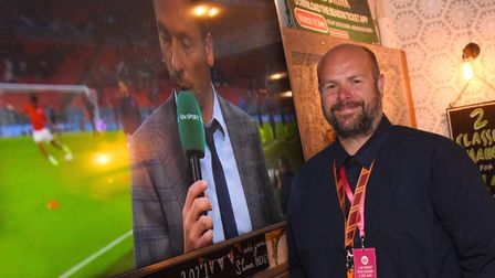 The Woolpack landlord, Ian Judge, by one of the big screens showing the England against Scotland mat