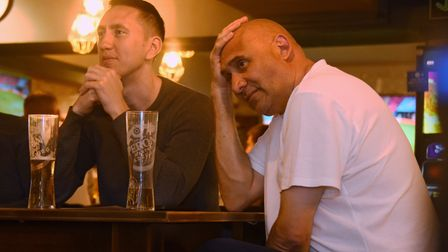 England fans watching at the Woolpack in Norwich, are tense as a goal is missed in the England again