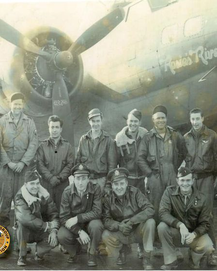 """U.S. Army Air Forces Lt. Col. Robert """"Rosie"""" Rosenthal, kneeling, second left, and his air and groun"""