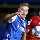 Birmingham City's Sam Cosgrove (left) and Reading's Andy Rinomhota battle for the ball during the Sk
