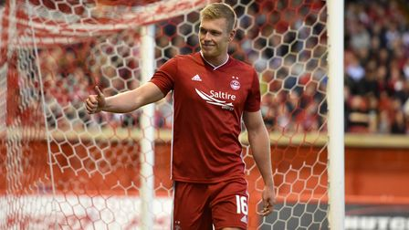 Aberdeen's Sam Cosgrove gestures to the fans after scoring his sides fifth goal of the game during t