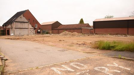 The empty plot where Budgens of Holt stood, pictured one year on from the fire. Picture: DENISE BRAD