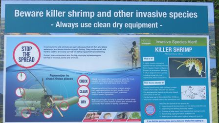 A sign warning anglers to help 'stop the spread' of killer shrimp at the Trinity Broads.